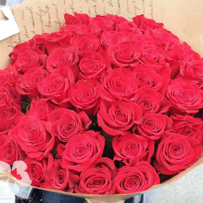 A bouquet of 51 long red roses